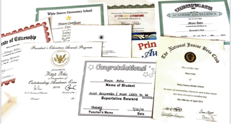 A pile of embossed certificates and awards given to the author.