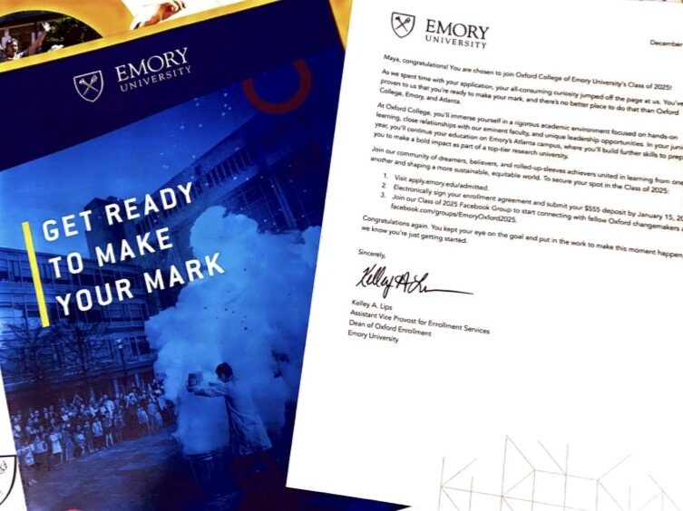 A blue Emory University packet and acceptance letter into Oxford College for the author.